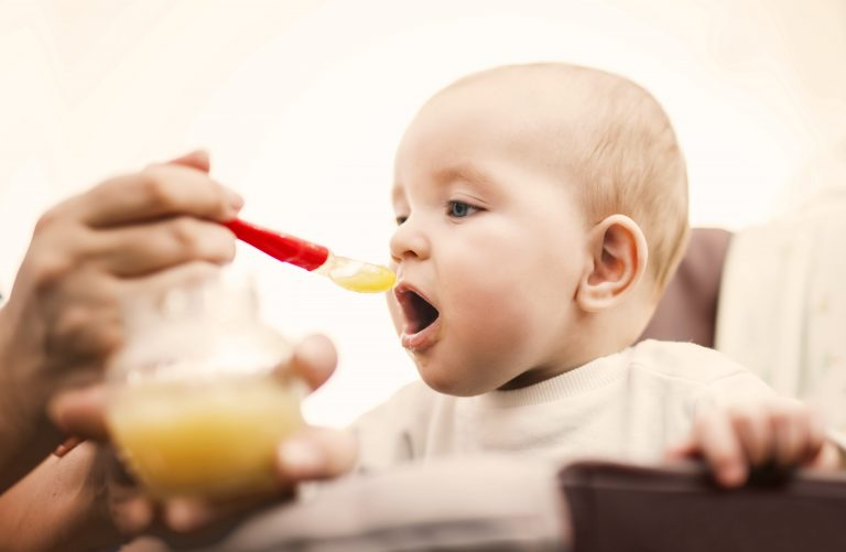 baby eating baby food - Sleep Solutions Unlimited