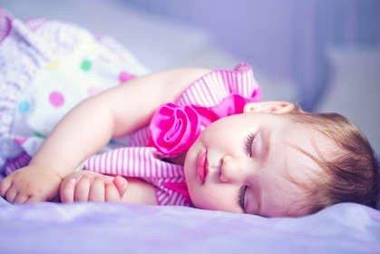 sleeping baby girl - JoAnna Inks Sleep Solutions
