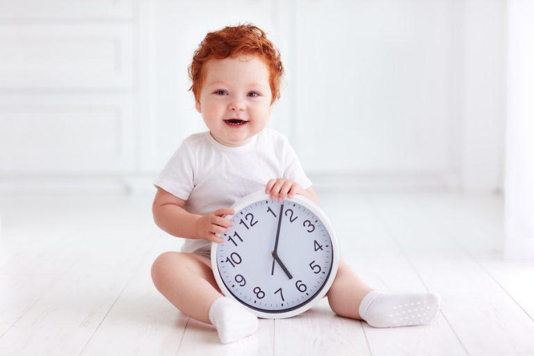 baby with a clock - JoAnna Inks Sleep Solutions