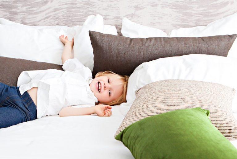 little boy on pillows - JoAnna Inks Sleep Solutions