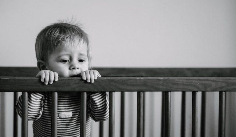 baby boy in a crib - JoAnna Inks Sleep Solutions