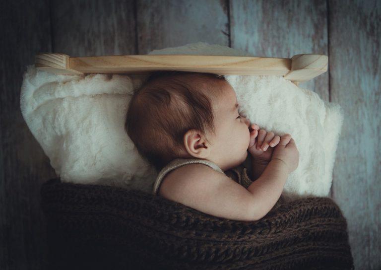 baby on a tiny bed - JoAnna Inks Sleep Solutions