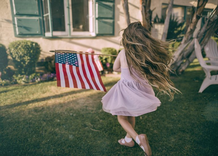 little girl with American flag - JoAnna Inks Sleep Solutions