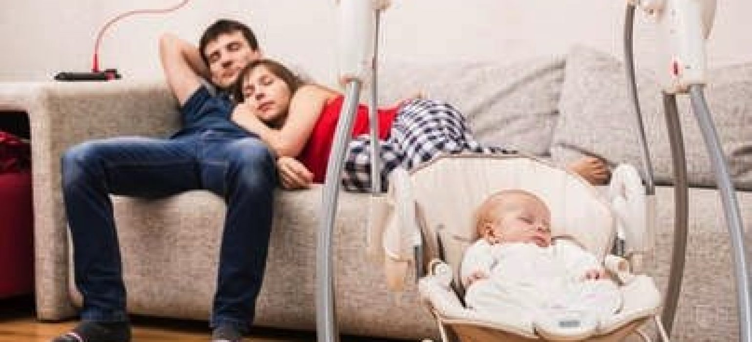 baby sleeping in a swing - Sleep Solutions Unlimited